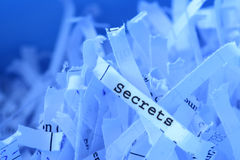 Shredded paper. With Secrets on it royalty free stock photos