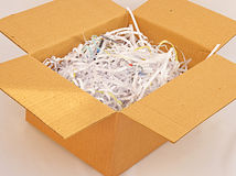 Shredded paper as packing material. An image of a parcel where shredded paper has been recycled as packing material. A ' green' concept image Stock Image