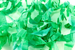 Shredded paper. A background of green shredded tissue paper Royalty Free Stock Images