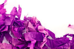 Shredded paper. A background of mauve shredded tissue paper with space for text Royalty Free Stock Image