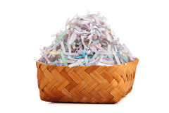 Shredded paper in bamboo busket. Stock Photos