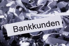 Shredded paper banking customers Stock Image