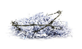 Shredded paper and barbed wire Royalty Free Stock Images