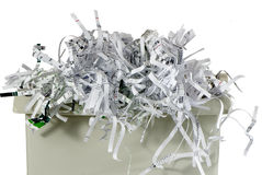 Shredded paper in a basket. On a white background Stock Images