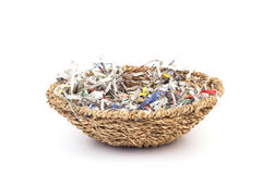 Shredded paper in basket. Isolate on white background Stock Photo