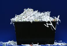 Shredded Paper In Box. Isolated shredded paper in black box stock photography