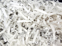 Shredded paper. Close up of paper that was shredded for confidentiality Royalty Free Stock Image