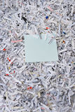Shredded paper & sticky note. A pile of shredded paper and a sticky note on top with room to add info Stock Photography