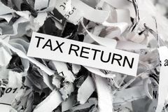 Shredded paper tax return Royalty Free Stock Images
