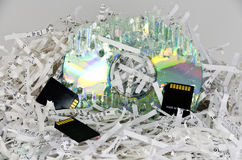 Shredded papers and data storage devices Stock Photos
