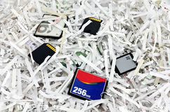 Shredded papers and data storage devices Royalty Free Stock Photography
