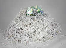 Shredded papers and a destroyed data disc Stock Image