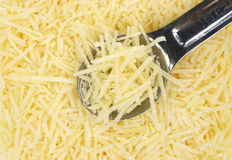 Shredded Parmesan cheese with spoon Stock Photography
