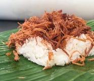 Shredded pork with sticky rice. Sweet shredded pork with steaming sticky rice northern Thai dish on banana Royalty Free Stock Image
