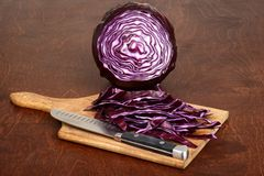 Shredded red cabbage and knife Royalty Free Stock Photography