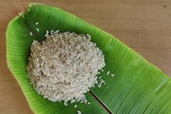 Shredded rice grain on banana leaf. Stock Photography