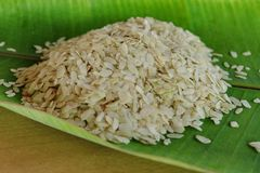 Shredded rice grain on banana leaf. Royalty Free Stock Photo