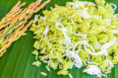 Shredded rice grain. With coconut, traditional Thai dessert on old wooden table Stock Photos