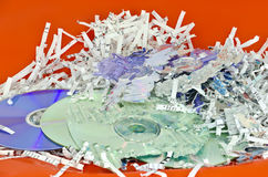 Shredded storage discs and  paper sheets Royalty Free Stock Image