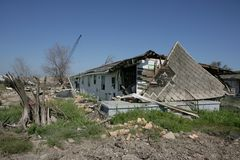 Shredded tree and house off foundation Stock Photography