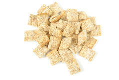 Shredded Wheat. Bite sized shredded wheat isolated on white Stock Images