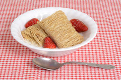 Shredded wheat with fruit in bowl Royalty Free Stock Images