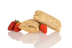 Shredded wheat with strawberries Stock Image