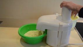Shreddering potatoes with electric shredder. pancake bake stock video