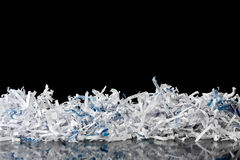 Shredding. Shredded paper with blurred reflection Royalty Free Stock Photography
