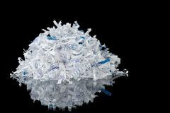 Shredding. Shredded paper on a black background Stock Images