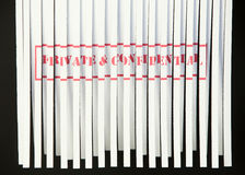 Shredding Document - Private & Confidential. A shredded document with Private and Confidential printed in red Royalty Free Stock Photo