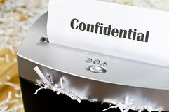 Shredding documents. Shredding private documents for security Royalty Free Stock Images