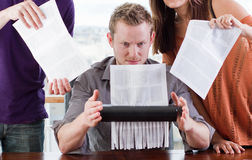 Shredding Evidence. Group of guilty workers franticly shred documents Royalty Free Stock Photo