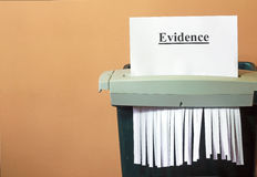 Shredding the evidence, hiding the truth. The evidence is being shredded in a machine to hide the truth. possibly from an investigation. Corruption in  progress Royalty Free Stock Photos