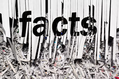 Shredding Facts. A shredder being used to hide the facts royalty free stock photos