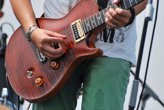 Shredding the Guitar. A close up photo of a guitarist in action Royalty Free Stock Photos