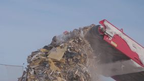 Shredding in the landfill, Russia. Shredding in the landfill at winter stock footage