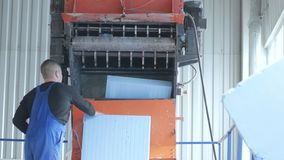 Shredding styrofoam, worker near automatic machine, stock video footage