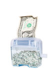 Shredding Your Money - $1. In hand shredder with shredded bills inside Royalty Free Stock Photos