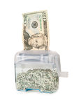 Shredding Your Money - $20. In hand shredder with shredded bills inside Stock Images