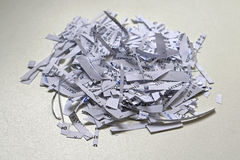 Shreddings. Shredding paper with confidential and senzitive private documents Royalty Free Stock Images
