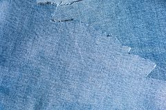 Shreds of denim fabric, unevenly cut jeans Royalty Free Stock Photo
