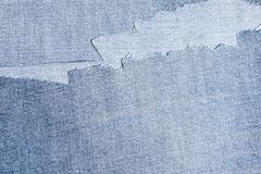 Shreds of denim fabric, unevenly cut jeans Royalty Free Stock Image