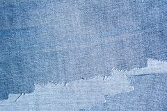 Shreds of denim fabric, unevenly cut jeans Stock Images