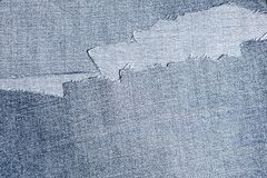Shreds of denim fabric, unevenly cut jeans Royalty Free Stock Photography
