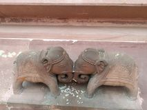 At Shree Mahavir Jee Jain temple Beautiful architecture of two cute elephants fighting each other. royalty free stock photography