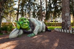 Shrek life-size figure lying in amusement miniature park, Antalya, Turkey. Life size statue of Shrek lying in the amusement miniature park Minicity in Antalya stock photography