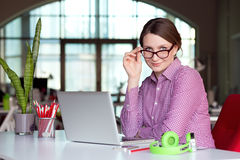 Shrewd female Manager in modern Digital Office Interior Stock Image