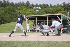 Shrewsbury Colonials game. High school batter for Shrewsbury Colonials plays against Nashoba Chieftans baseball team in daylight game, Shrewsbury, MA Stock Photo