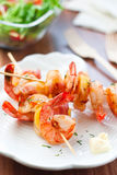 Shrimp. S on wooden rods with a potato Royalty Free Stock Photography